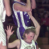 1/5/99---White Oak's (21) fouls Spring Hill's (14) as she falls during a rebound in Tuesday's game at White Oak High School. bahram mark sobhani