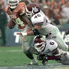 Date:   1/1/99---Texas running back Ricky Williams runs with the ball as MSU's #46 DE Larry Campbell, and #6 CB Anthony Derricks during the Cotton Bowl Friday morning in Dallas. Kevin green