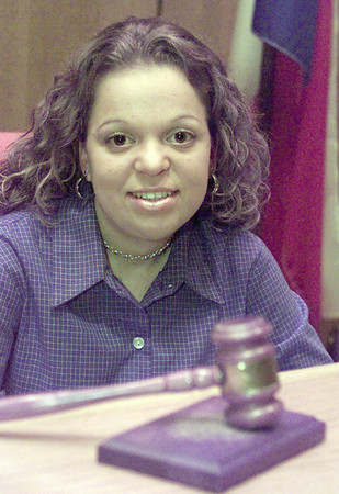 1/14/99---Hallsville High School student Lauren Alexander sits at the judge's bench in the Longview Municipal Courtroom. Alexander volunteers as an attorney for Teen Court. bahram mark sobhani