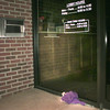 Date:   1/8/99---A boquet of flowers lies at the door of the First Federal Savings Bank of North Texas branch office on East Marshall in Longview, where a bank teller was slain and a bank manager injured during a robbery Thursday afternoon. Kevin green