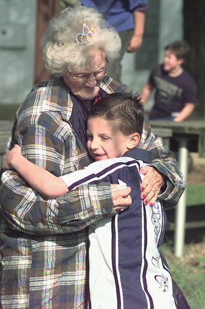1/30/99---Ty Senn, 6, of Longview, hugs his great-great-great-grandmother, Martha Ann Horn, who was celebrating her 101 birthday with family and friends Saturday in Stewart. bahram mark sobhani