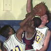 Date:   1/22/99---Pine Tree's (20) and (50) apply stiff pressure to a Whitehouse shooter in the second half of their game Friday at Pirates Gym. bahram mark sobhani