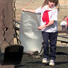 Date:   1/25/99---St. Mary's kindergarden student Caitlin Lee, helps other students as they pick-up trash on the playground Monday afternoon at St. Mary's in Longview. Kevin green