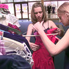 Date:   1/23/99---Sarah Kirk, left, a senior at PTHS looks over the prom dresses with PTHS junioir Paige Weldon, right, during the In-Prom-Two consignment sale Saturday morning at the PTHS little theater in Longview. Kevin green