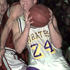 1/22/99---Pine Tree's Kevin Daniels (24) finds it hard to get around the Whitehouse defense as he attempts a shot in the second half of their game Friday. bahram mark sobhani