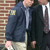Date:   1/7/99---FBI officials remove the surveillance camera from First Federal Savings Bank of North Texas in effort to yield clues or evidence in Thursday's armed bank robbery which left one employee dead and one wounded.