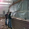 Date:   1/22/99---Glenn Cary, left, a carpenter, and Virgil Newman, right, leadman, both with Transet General Construction of Longview, nail boards in to secure the plastic as they prepare for rain as consatruction continues on the GSMC clinic on Mobberly. Kevin green
