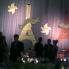 "1/30/99---Folks mingle Saturday night at the Junior League Charity Ball as a couple of Eiffel Towers rise in the background Saturday night. The theme for the event was ""An Evening in Paris."" bahram mark sobhani"