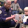 Date:   1/22/99---Cypress Black Bayou park ranger Sam Thornton, left, lets Rollen Robertson,4, hold little Sam a two year old American Alligator Friday eveing at the Boat SHow at Maude Cobb in Longview. Kevin green
