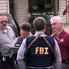 """Date:   1/7/99---FBI agent Jim Wilkins talks with Marshall Police Chief Charles """"Chuck"""" Williams, right, as the investigation into a bank robbery in Longview continued in Marshall where the suspects fled. kevin green"""