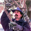 Date:   1/4/99----Fidel Mendoza leans a hand during community service Monday afternoon as he helps employees from Cheyenne Electric remove the Christmas lights form the Gregg County Courthouse and lawn in Longview. Kevin green