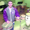 Date:   1/15/99---White Oak junior band member Daniel Jones in a practice room with instruments. Kevin green