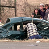 Date:   1/14/99---Two students are comforted at the scene of an accident involving three vehicles, while paramedics continue to free people from one of the cars at Texas FM 349 and Texas 322 in Lakeport Thursday afternoon. Kevin green