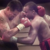 7/23/99---Bobby Scroggins of Dallas, right, lands a body blow to Carlos Dalasos from Alamogordo, NM Friday at the Maude Cobb Activity Center. bahram mark sobhani