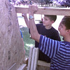 7/29/99---LeT camp counselor Garrett Day, right, helps Andrew Alstin,10, hammer in a nail duirng the construction kids camp Thursday morning at LeT campus in LGv. Kevin green