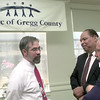 7/21/99---Left to Right---Lee Brown, left, with Sabine Valley, Inman White ex dir of Sabine Valley Center, and Mike Bright, right, t6he ex dir of The Arc of Texas visit during a reception Tuesday morning at the Longview Community Center. Kevin green