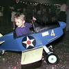 7/15/99---Gordie White III, takes a ride in a child-size airplane simulator Thursday at the Great Texas Balloon Race Kick Off Party at the Maude Cobb Convention and Activity Center. White's mother, Cheri, is a balloon pilot in the race, visiting from Houston. The airplane simulator was donated to the race by Stepping Stones to Aviation, and will have a display at the balloon race. bahram mark sobhani