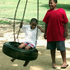 7/19/99-Demarcus Horn, 5, son of Bryan and Judy Horn, gets a push on the tire swing from his brother Ryan Horn, 11, Monday afternoon at Teague Park in Longview. Jessica Williamson