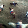 7/13/99---A rider is circled by other members of the Panola County 4-H Precision Drill Team as they practice at Panola County Rodeo Arena. bahram mark sobhani
