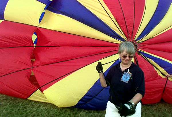 7/16/99---Jean Edwards, crew chief for Texas Twist, holds down the top as the balloon is inflated Friday. bahram mark sobhani