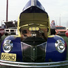 7/1/99---A classic car with it's hood up exposes it's engine for onlookers. bahram mark sobhani