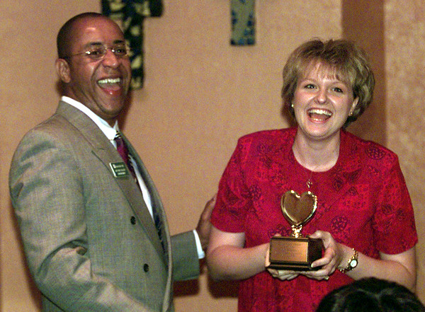 7/22/99--LISD Super Arthur Culver presents LNJ education reporter Becky Bell the Golden Heart award during an appreciation luncheon for the media Thursday afternoon at Papacita's in LGV. Kevin green