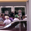7/12/99---People line up at the new Caring and Sharing location on the corner of Cotton St and Mobberly Ave. Monday afternoon in Longview. Kevin green