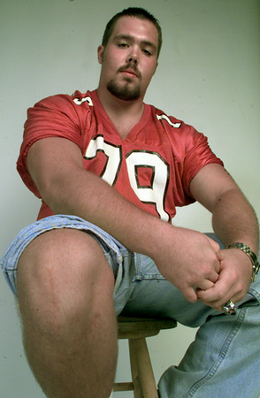 7/21/99---Elysian Fields football player D.J. Holcomb shows his right knee, which he had reconstructive surgery on. bahram mark sobhani