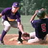 7/4/99---Buffalo's #12 second baseman Ronnie Hennesey, left, catches the ball while Spring Hill's #5Ricky Broyles, right, slides safely into second during Saturday's game at LHS field in Longview. Kevin green