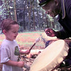 7/10/99---Michael Eaton, the 3 year old son of Jeff and Elise Eaton of Ft. Worth beats a native American drum while park ranger Jerry Beckworth, right, while he portrays a Texas Buffalo Soldier Saturday afternoon at Martin Creek State Park. Kevin green