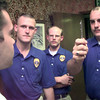 7/1/99---Matt Gilbert, left, of Tyler, watches the pen as East Texas Police Academy students Patrick Henderson, center left, of LOngview, David Faught, center, of Jacksonville, and Shane Dinger, right, of Tyler, performs the field sobriety test on the test subject Thursday afternoon at the Coors Hospitality Room in Longview. Kevin green