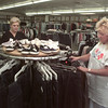 7/31/99---Sara Newell, left, store manager at R.A.C.E. Way Depot Thrift Store Supercenter, and Lou Ann Barnes arrange a new clothing rack Saturday at the store. Proceeds from R.A.C.E. Way goes to reach children twelve and under for Christ. bahram mark sobhani