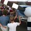 6/30/99---Members of Fellowship Bible Church of Longview, family and friends of Mike Bunn gather to pray around his Helio Courier plane Wednesday at the LeTourneau University flight school at Gregg County Airport. bahram mark sobhani<br /> ROBIN HAS DETAILED CUTLINE