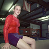 7/2/99---Lindsey Blundell poses on a vault, with the American and Australian flags hanging in the background. Blundell received the Australian flag when she traveled there for competition last year. bahram mark sobhani