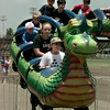 7/25/99-Ashley Darden, front seat, 11, daughter of Dennis and Laura Darden of Kilgore, and Tiffany Wagner, second seat, 13, daughter of Allen and Hope Wagner, and others take a cruise on the Dragon Wagon Saturday afternoon at the Northeast Texas Regional Fair in Longivew.  Jessica Williamson