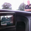 7/23/99---LPD SGT. James Johnson is seen on the LCD TV monitor in the patrol car as he stands outside in front of the car during a denmonstration of the city's new patrol car mounted video cameras Friday afternoon at the PD in LGV. Kevin green