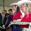 7/23/99---KC rangerettes Angela Brown, left, and Anna May, right, anchor the right side of the ribbon during the 50th anniversary ceremony of Citizens National Bank in Kilgore. Kevin green