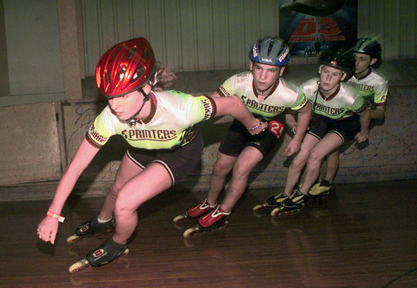 7/8/99---Danielle Danis, Austen Chambliss, Audrey Pendley and Damien Penn, from left, practice their inline speedskating Thursday at Skateland in Longview. bahram mark sobhani