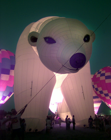7/16/99-The Polar Bear balloon, one of the biggest shaped balloons at the race, glows during the GTBR balloon glow Friday night in Longview.   Jessica Williamson
