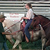 7/13/99---Nicky Parker coaches 4-H Precision Drill Team riders as they practice their routine at the Panola County Rodeo Arena. Parker, who is one of the 4-H leaders, was a member of the team in the 1960s. bahram mark sobhani