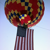 7/16/99-The Longview Mall balloon raises the American Flag during the National Anthem to kick off the beginning of the balloon glow Friday night in Longview.   Jessica williamson