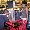 7/16/99---Jamie Green,.7, shops with her mom Staci Green of Hallsville, Friday afternoon at Target in LGV. Kevin green