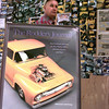 7/20/99-Sidney Allen stands in his shop by an enlarged cover of the car magazine in which his 1956 Ford F150 truck was featured.  Jessica Williamson