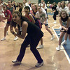 7/14/99-Sophomore Rangerette Jamie Vallejo helps lead girls in a dance at a Rangerette camp held Wednesday afternoon in Kilgore.   Jessica Williamson