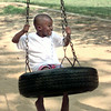 7/19/99-Demarcus Horn, 5, son of Bryan and Judy Horn goes for a ride on the tire swing Monday afternoon at Teague Park in Longview.  Jessica Williamson