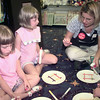 7/22/99--Hannah Gawin,4, left, and Hailey Gawin,6, center, granddaughters of Kay Califf, of Carthage, ILL., get help from Books A Million employee Maria Hughes, right, while making picture frames after story time Thursday afternoon at Books A Million in LGV. Kevin green