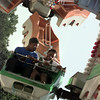 7/25/99-Brandon Pleasant ,left, 14, of Dallas, and Bershandia Rossum, 11, of Gilmer, enjoy a ride on the Orbiter Saturday afternoon at the Northeast Texas Regional Fair in Longview.  Jessica Williamson
