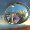 6/14/99-Brandy Massey, age 7, daughter of Obie and Melissa Massey, relaxes in the shade of the rocketship jungle gym at McWhorter Park Monday afternoon in Longview. Jessica Williamson