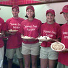 6/23/99-(left to right) Shawn Hill, Kevin Hill, Crystal Barnard, Ashley Hill and Harry Lawyer show some of the many varieties of funnel cakes they offer at their new shop in the food court in the Longview Mall. Shawn, Kevin and Ashley are the owners of The Funnel Cake Factory.  Jessica Williamson