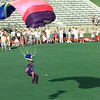 Skydiver landing in the middle of Lobo Stadium at the I n God We Trust patriotic rally held at Longview High School Sunday. ObieLeBlanc